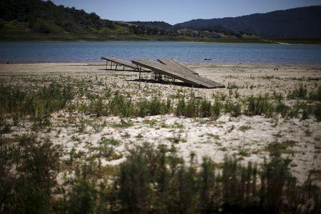 Boat ramps sit on the dry bed of a part of Lake Casitas that was formerly under water in Ojai, California April 16, 2015. REUTERS/Lucy Nicholson