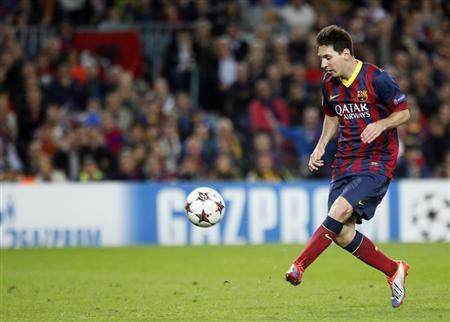 Barcelona's Messi kicks the ball to score his second goal against AC Milan during their Champions League soccer match in Barcelona