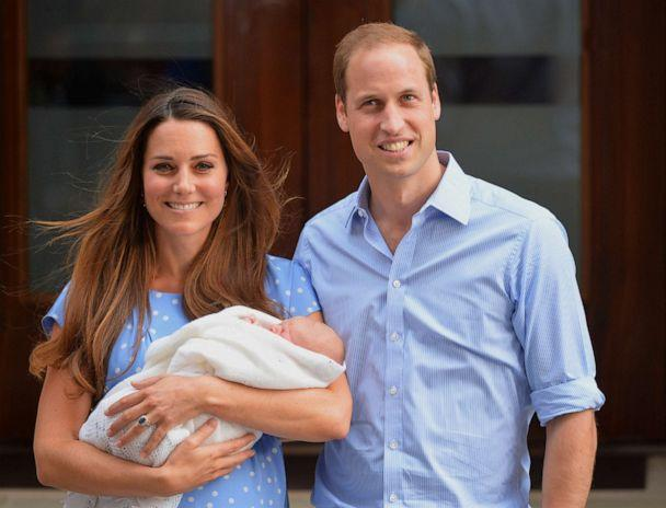 PHOTO: Prince William and Catherine, Duchess of Cambridge show their new-born baby boy to the world's media, standing on the steps outside the Lindo Wing of St Mary's Hospital in London on July 23, 2013. (Leon Neal/AFP via Getty Images)