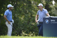 Abraham Ancer, of Mexico, left, talks with Sam Burns before teeing off on the fifth hole during the first round of the BMW Championship golf tournament, Thursday, Aug. 26, 2021, at Caves Valley Golf Club in Owings Mills, Md. (AP Photo/Nick Wass)