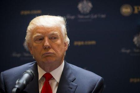 Real estate developer Donald Trump looks on during a news conference with the PGA in New York