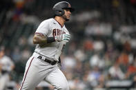 Arizona Diamondbacks' David Peralta runs down the first base line after hitting an RBI single against the Houston Astros during the 10th inning of a baseball game Friday, Sept. 17, 2021, in Houston. (AP Photo/David J. Phillip)