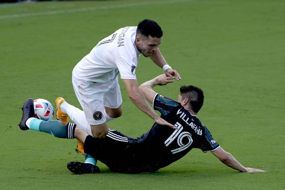 Inter Miami midfielder Lewis Morgan (7) and LA Galaxy defender Jorge Villafana (19) collide during the first half of an MLS soccer match, Sunday, April 18, 2021, in Fort Lauderdale, Fla. (AP Photo/Lynne Sladky)