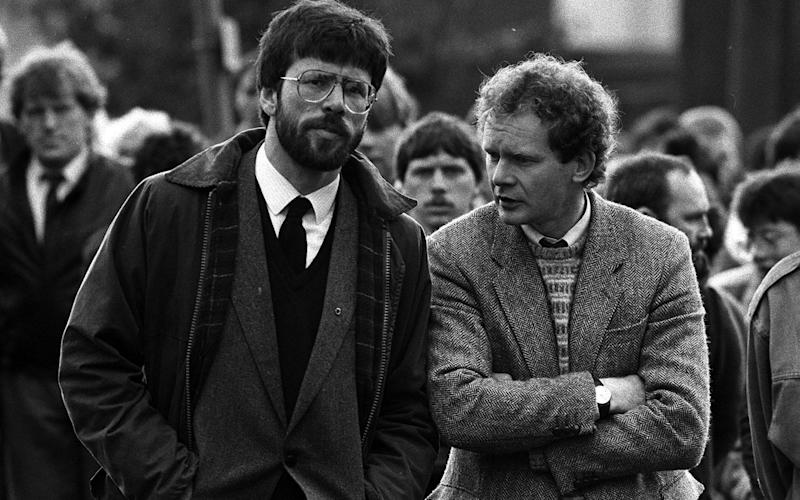 Gerry Adams and Martin McGuinness at the funeral of Patrick Kelly in May 1987  - Credit: PA