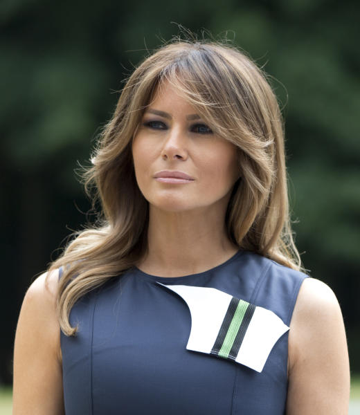 U.S. first lady Melania Trump waits for other spouses prior to a group photo at the Queen Elisabeth Music Chapel in Waterloo, Belgium, during a spouses program on the sidelines of the NATO summit on Wednesday, July 11, 2018. (AP Photo/Virginia Mayo)