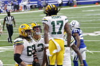 Green Bay Packers' Davante Adams (17) celebrates a touchdown with teammates during the first half of an NFL football game against the Indianapolis Colts, Sunday, Nov. 22, 2020, in Indianapolis. (AP Photo/AJ Mast)