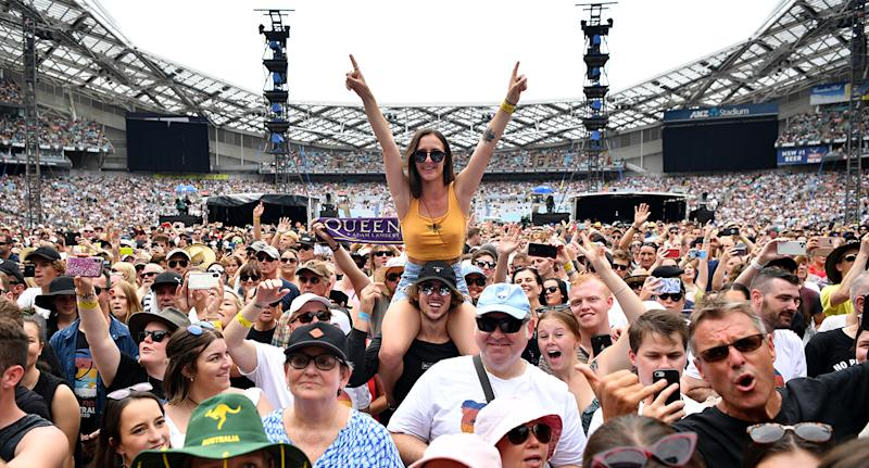 Fans in the crowd during the Fire Fight Australia bushfire relief concert at ANZ Stadium in Sydney. Source: AAP