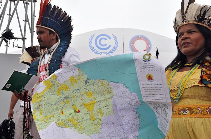 Members of the Association of Indigenous Peoples of Brazil, demonstrate for their cause during the UN COP20 and CMP10 climate change conferences in Lima on December 8, 2014 (AFP Photo/Cris Bouroncle)