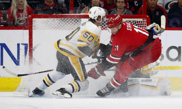 Carolina Hurricanes' Jordan Staal (11) crashes into Pittsburgh Penguins' Juuso Riikola (50) and goaltender Matt Murray (30) during the first period of an NHL hockey game, Saturday, Dec. 22, 2018, in Raleigh, N.C. (AP Photo/Karl B DeBlaker)