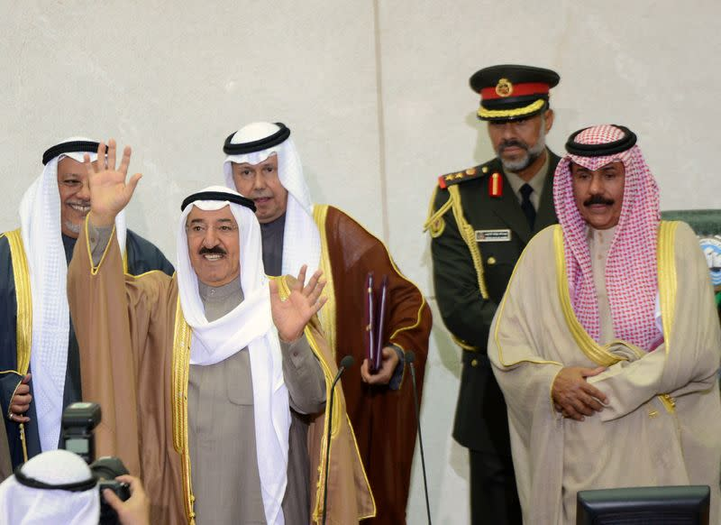Emir Sheikh Sabah al-Ahmad al-Sabah waves as he finishes opening the 14th session of Parliament in Kuwait City