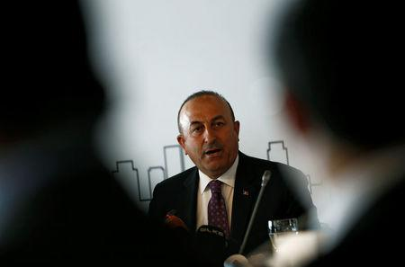 Turkish Foreign Minister Cavusoglu speaks during a meeting with foreign diplomats in Istanbul