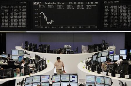 Traders are pictured at their desks in front of the DAX board at the Frankfurt stock exchange August 26, 2013. REUTERS/Remote/stringer