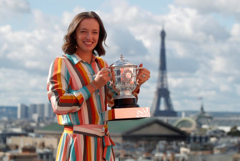 FILE PHOTO: Poland's Iga Swiatek poses with the trophy after winning the French Open