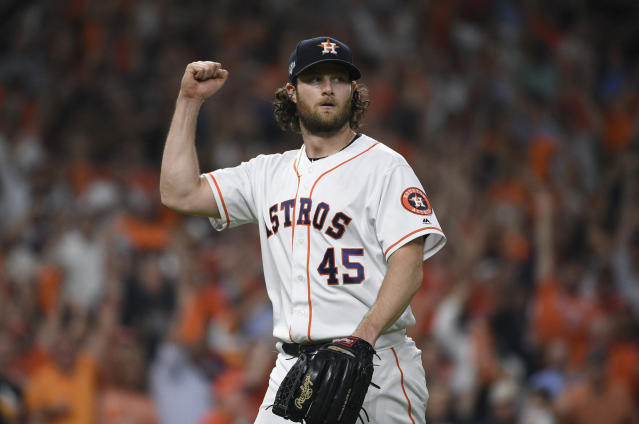 Houston Astros starting pitcher Gerrit Cole (45) reacts after an out against the Tampa Bay Rays during the seventh inning of Game 5 of a baseball American League Division Series in Houston, Thursday, Oct. 10, 2019. (AP Photo/Eric Christian Smith)
