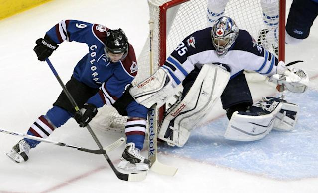 Colorado Avalanche center Matt Duchene (9) drives to the goal against Winnipeg Jets goalie Al Montoya (35) during the first period of an NHL hockey game in Denver on Sunday, Dec. 29, 2013. (AP Photo/Joe Mahoney)