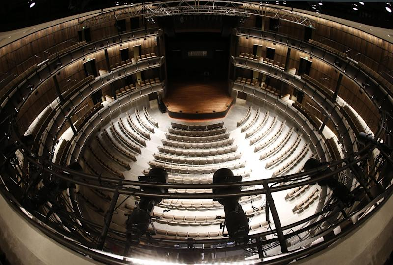 In this April 10, 2014, photo, the circular CMA Theater is seen at the Country Music Hall of Fame and Museum in Nashville, Tenn. A $100 million expansion provides more interactive and contemporary exhibits as well as providing new meeting and performing space. (AP Photo/Mark Humphrey)