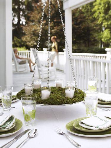 """<p>This alfresco chandelier comes together easier than it looks, but the suspended candles (or flowers!) will make an instant impression.</p><p><em><a href=""""https://www.goodhousekeeping.com/home/gardening/advice/g1317/plant-arrangements/?slide=4"""" rel=""""nofollow noopener"""" target=""""_blank"""" data-ylk=""""slk:Get the tutorial »"""" class=""""link rapid-noclick-resp"""">Get the tutorial »</a></em> </p>"""