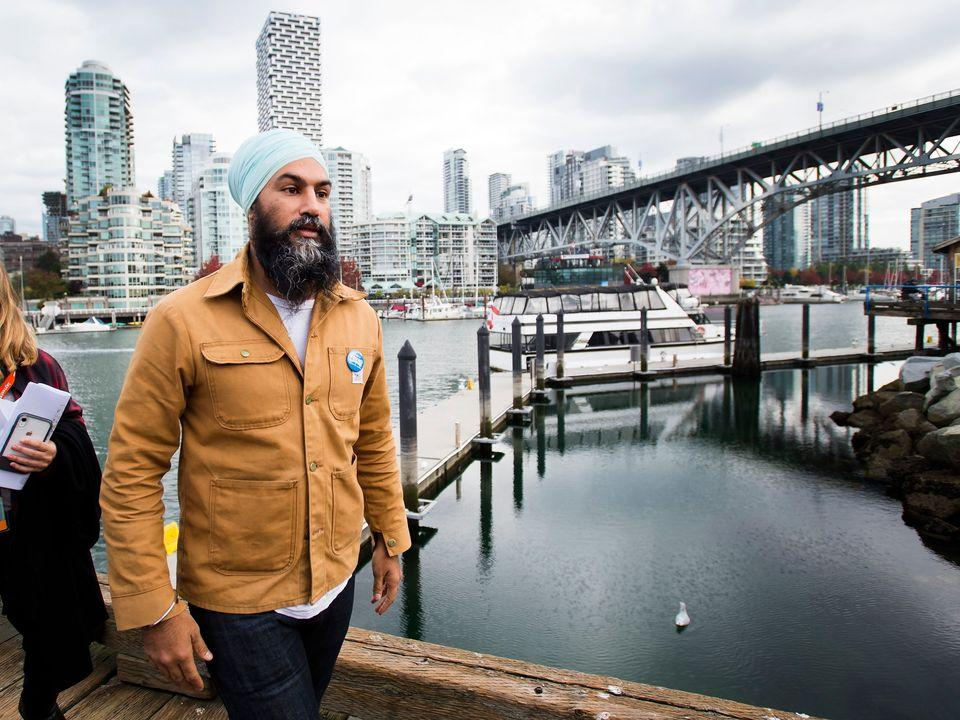 NDP leader Jagmeet Singh leaves the boardwalk after speaking to the media during a campaign stop at Granville Island in Vancouver on Oct. 14, 2019.