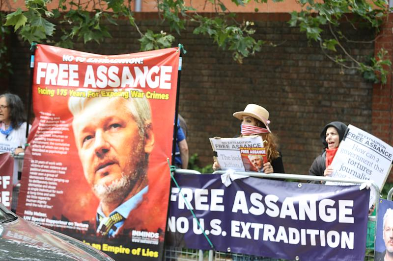 LONDON, UNITED KINGDOM, JULY 10: Activists protest UK government for imprisonment in London and possible extradition of Julian Assange to US before the Global Conference on Press Freedom begin in London, United Kingdom on July 10, 2019. (Photo by Tayfun Salci/Anadolu Agency/Getty Images)