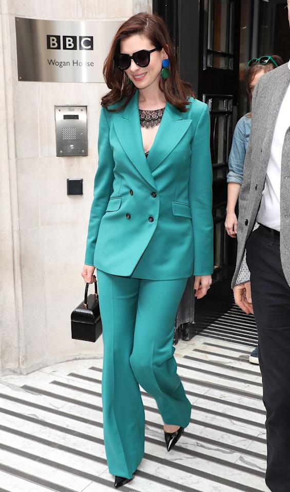 """<p><strong>17 April </strong>Anne Hathaway looked chic in a green Gabriela Hearst suit in London.</p><p><a rel=""""nofollow"""" href=""""https://www.farfetch.com/uk/shopping/women/gabriela-hearst-classic-double-breasted-blazer-item-13617364.aspx?pid=rakuten_int&af_click_lookback=30d&clickid=8_btisdd0hQ-ryzgldaKkxHyKbYxGBVF6A&af_sub1=35653&af_siteid=8%2Fbtisdd0hQ&af_sub_siteid=183381&af_cost_model=CPA&af_channel=affiliate&is_retargeting=true&ranSiteID=8_btisdd0hQ-ryzgldaKkxHyKbYxGBVF6A"""">SHOP HER SUIT</a></p>"""