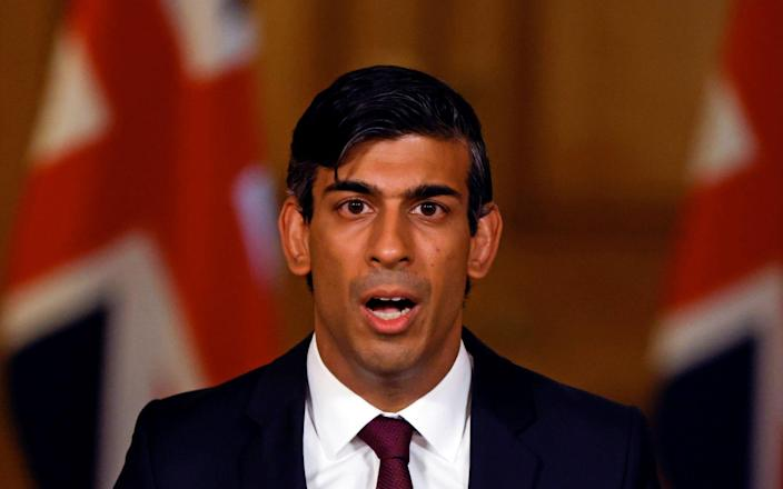 Britain's Chancellor of the Exchequer Rishi Sunak hosts a remote press conference to update the nation on his economic measures - AFP