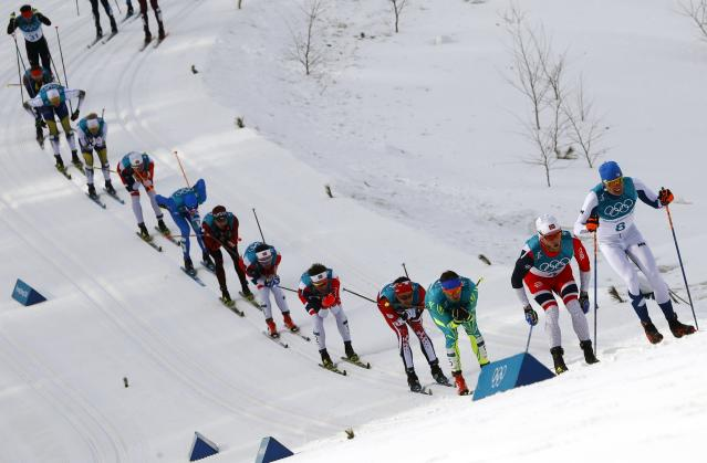 <p>Iivo Niskanen of Finland leads the pack. REUTERS/Kai Pfaffenbach </p>