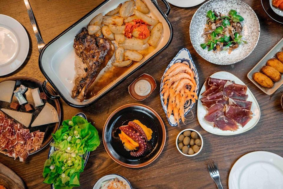 "<p>The word ""feast"" isn't used lightly when it comes to the Spanish Tapas restaurant Iberica's at home feasting <a href=""https://iberica.vmos.io/store/store-selection?app=online"" rel=""nofollow noopener"" target=""_blank"" data-ylk=""slk:box"" class=""link rapid-noclick-resp"">box</a>. Shipped every Thursday to arrive within 48 hours at your door, each box allows you to assemble a delectable meal in the comfort of your own kitchen (with all the difficult steps already completed). The kit includes generous helpings of cured meats, a selection of artisan cheeses, and Torreznos and Manzanilla olives. For the main event, enjoy a leg of milk-fed lamb with potatoes, roasted onion petals and Cantabrian sea anchovies. (There are even whole prawns and octopus inside the selection, too.) To round it all off is some Gloria cheesecake to satisfy any sweet cravings. </p>"