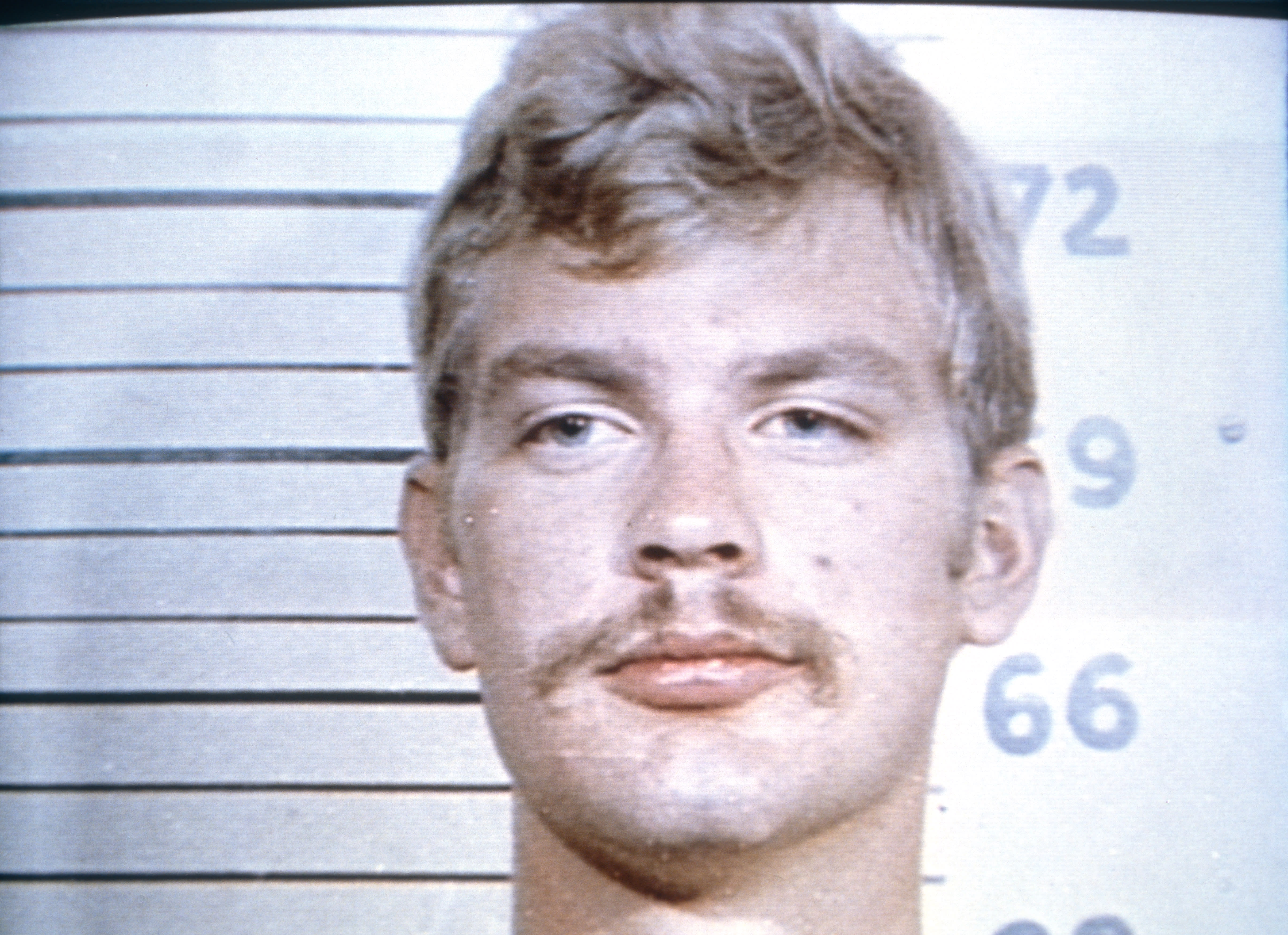 Serial killer Jeffrey Dahmer shown in a police mug shot from his 1982 arrest at the Wisconsin State Fair for indecent exposure. (Photo by Ralf-Finn Hestoft/Corbis via Getty Images)
