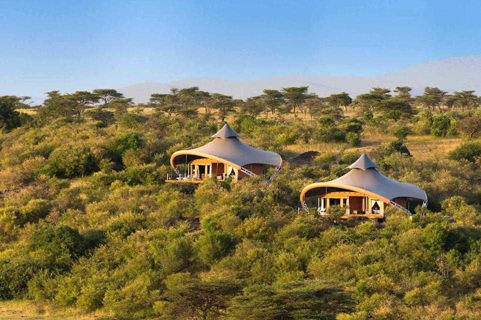 Two guest villas tucked into trees at Mahali Mzuri, voted one of the best hotels in the world