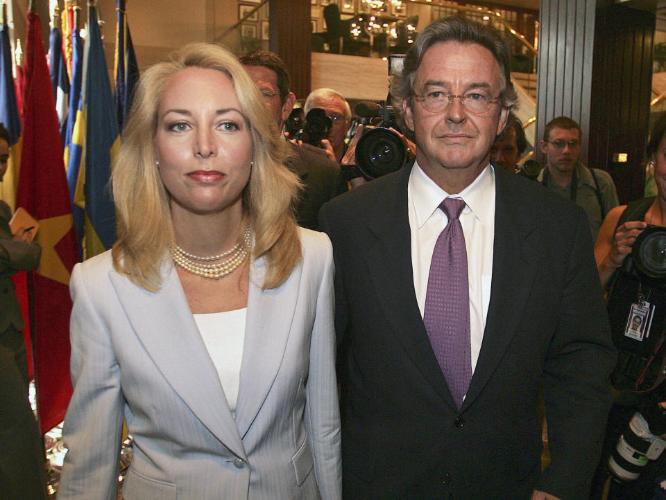 FILE - In this July 2, 2007 file photo, former CIA officer Valerie Plame, left, and her husband, former ambassador Joseph Wilson, arrive for a news conference at the National Press Club in Washington in this July 14, 2006, file photo. Wilson, the diplomat who disputed pre-war intelligence on Iraq and endured retribution, has died. He was 69. Valerie Plame confirmed in a text message that Wilson died Friday, Sept. 27, 2019, of organ failure in Santa Fe, N.M. She called him a patriot with the heart of a lion. Wilson's denial of pre-war intelligence under the administration of President George W. Bush touched off retribution against Plame and a criminal cover-up. (AP Photo/Lawrence Jackson, File)