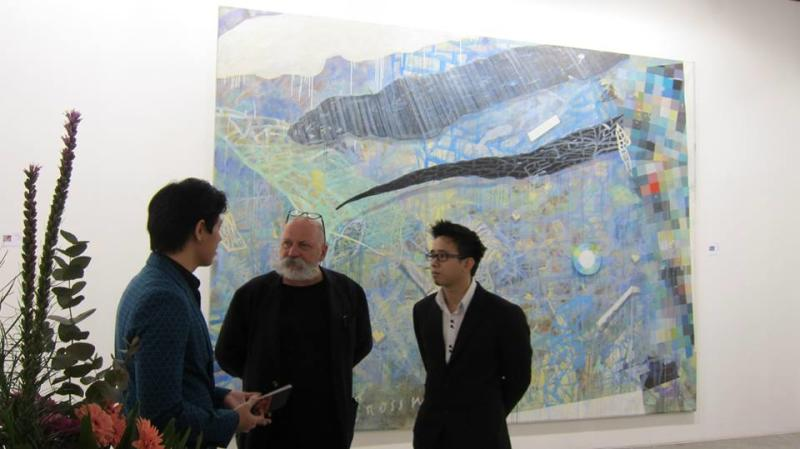 Milenko Prvacki standing in front of his artwork that sold for S$120,000 (Photo by iPreciation)