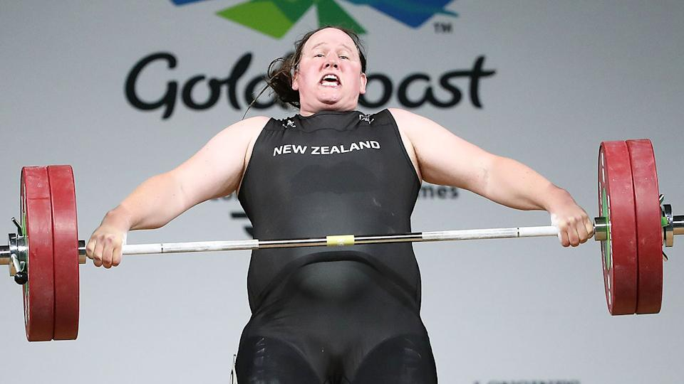 Seen here, transgender weightlifter Laurel Hubbard strains to lift a bar in competition.
