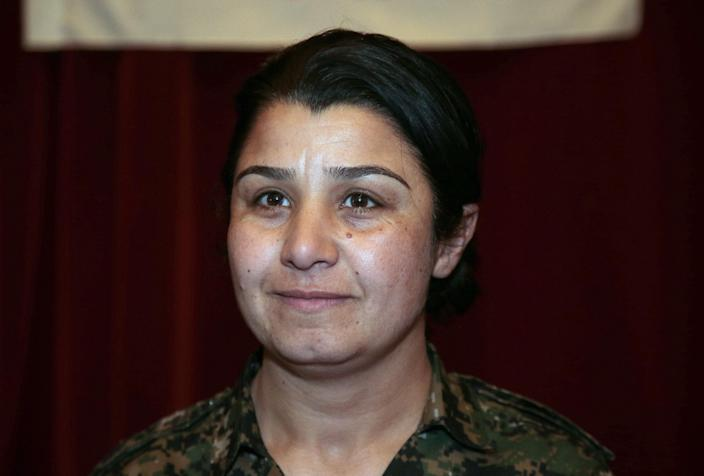Nassrin Abdallah, a Kurdish woman who led one of the brigades that fought for the liberation of the Syrian town of Kobane, answers questions during a press conference in Paris, on February 9, 2014 (AFP Photo/Jacques Demarthon)