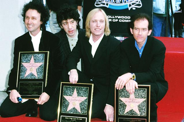 <p>Tom Petty and the Heartbreakers are honored with a star on the Hollywood Walk of Fame on April 28, 1999, in Hollywood. (Photo: S. Granitz/Getty Images) </p>