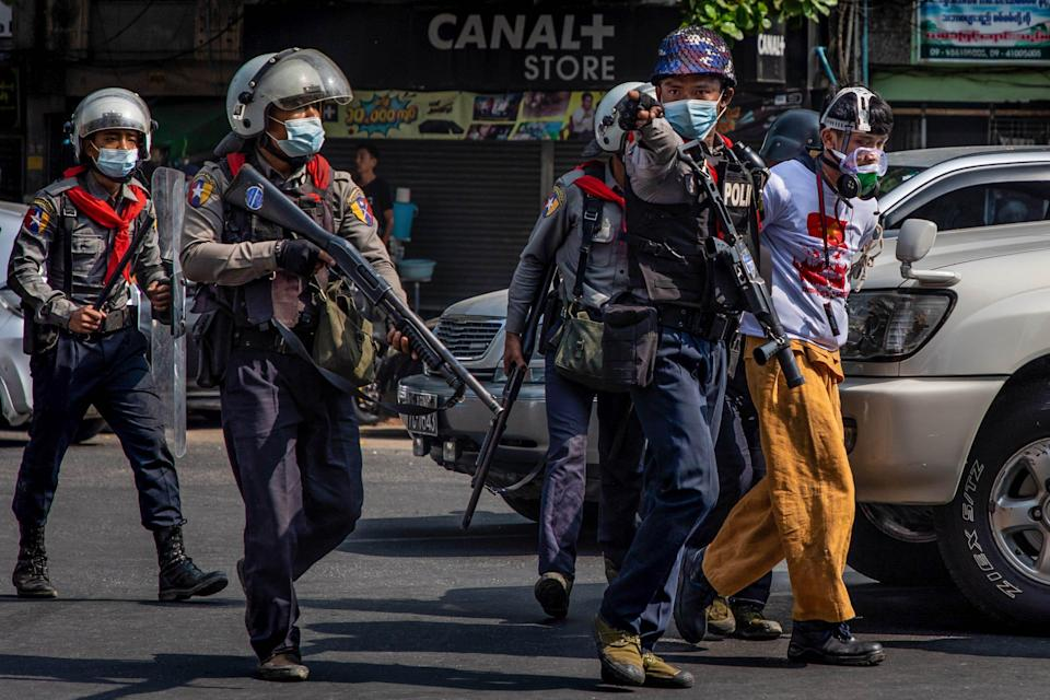 Riot police arrest protesters Feb 27 in Yangon, Myanmar. The military government has intensified a crackdown on demonstrations.