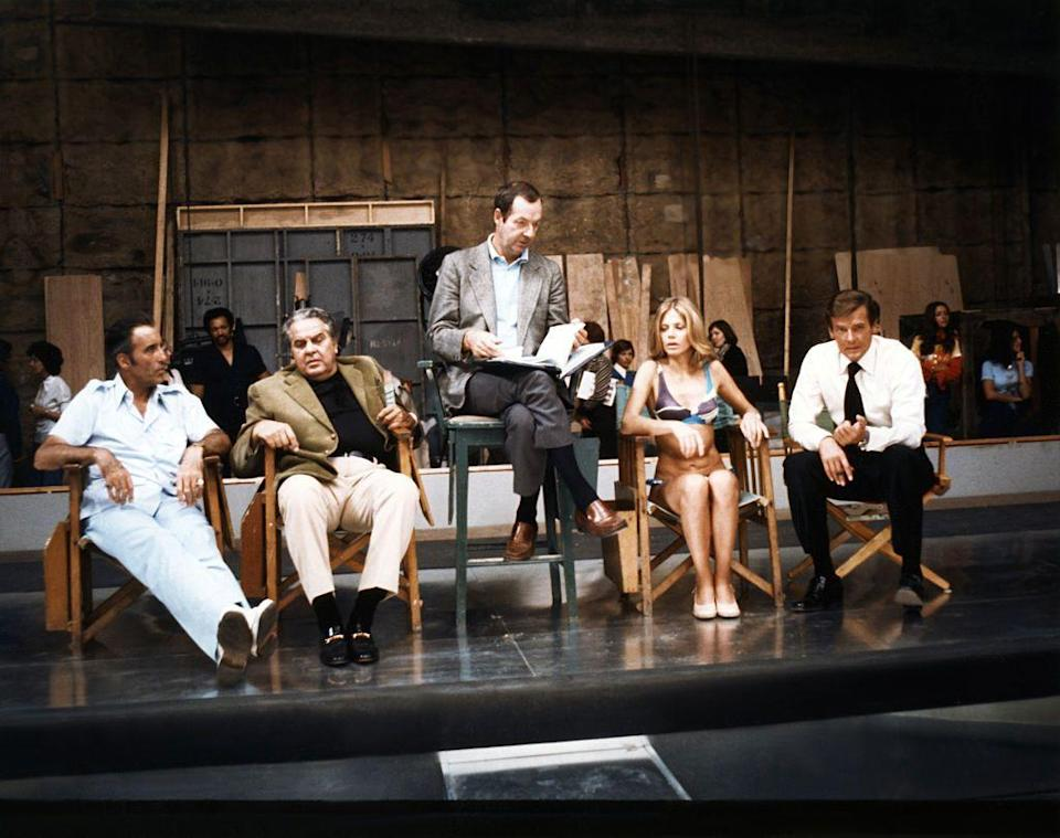 <p>Christopher Lee, Britt Ekland and Roger Moore with American producer Albert R.Broccoli, and British director Guy Hamilton on the set of his movie 'The Man with the Golden Gun' 1974.</p>