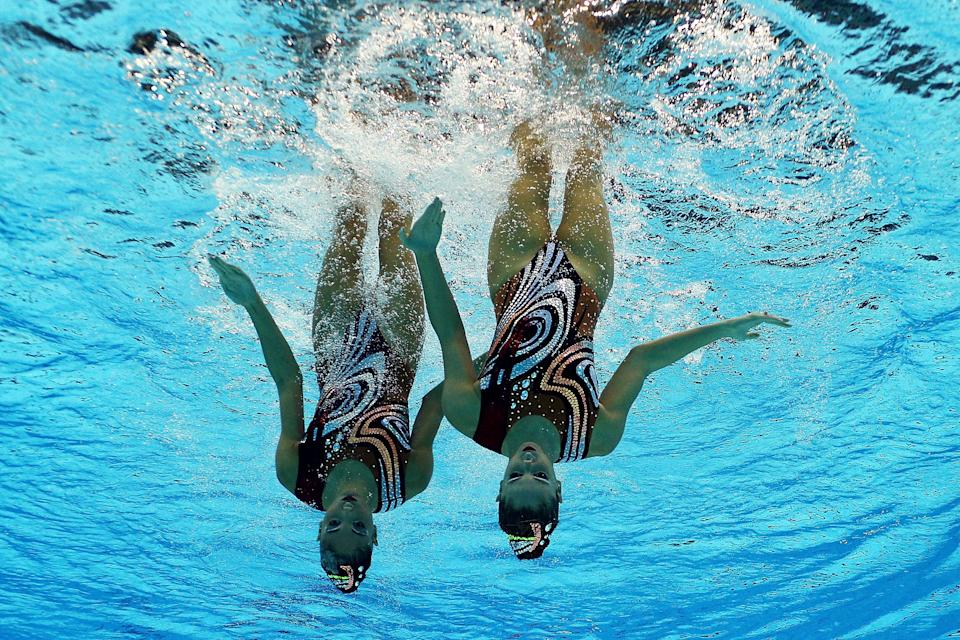 Evangelia Platanioti and Desponia Solomou of Greece compete in the Women's Duets Synchronised Swimming Free Routine Final on Day 11 of the London 2012 Olympic Games at the Aquatics Centre on August 7, 2012 in London, England. (Photo by Clive Rose/Getty Images)