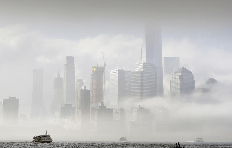A commuter ferry crosses the Hudson River to New York City, Wednesday, April 5, 2017, in this photo from Hoboken, N.J. Many commuters are shifting to the ferry service following Monday's derailment of a NJ Transit train which has lead to reduced train service into New York. (AP Photo/Mark Lennihan)