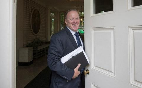 Former White House press secretary Sean Spicer stands in the doorway to the Palm Room at the White House in Washington, Friday, Aug. 11, 2017, during renovations to the West Wing - Credit: AP