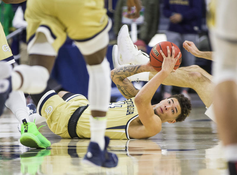 Georgia Tech's Jordan Usher (4) looks to pass the ball from the floor during the second half of an NCAA college basketball game against Notre Dame, Saturday, Feb. 1, 2020, in South Bend, Ind. Notre Dame won 72-80. (AP Photo/Robert Franklin)