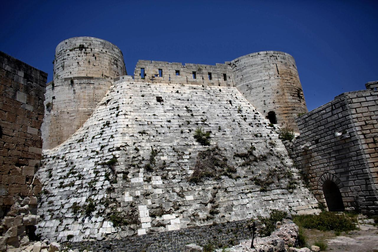 This photo made on Thursday, May 1, 2014, shows Crac des Chevaliers, the world's best preserved medieval Crusader castle, in Syria. The Crac des Chevaliers, some 40 kilometers (25 miles) west of Homs and just north of the Lebanese border, like many of the country's most significant historical sites, was caught in crossfire during a conflict that activists say has killed more than 150,000 people. Some sites have been turned into military bases. Shelling has smashed historic mosques, churches and markets. Looters have stolen artifacts from excavations and museums. (AP Photo/Dusan Vranic)