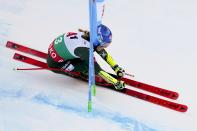 United States' Mikaela Shiffrin powers past a gate as she speeds down the course during an alpine ski, women's World Cup super-G, in Bansko, Bulgaria, Sunday, Jan. 26, 2020. (AP Photo/Giovanni Auletta)