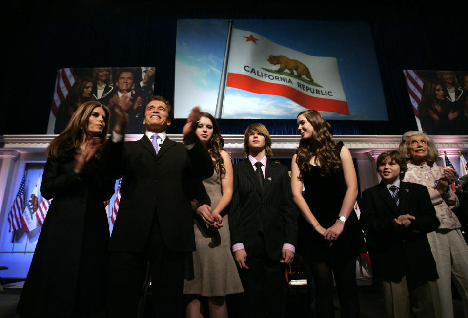 """FILE -- In this Jan. 5, 2007 file photo, Gov. Arnold Schwarzenegger is seen with his family, wife Maria Shriver, left, daughter Katherine, third from left, son Patrick, fourth from left, daughter Christina, fifth from left, son Christopher, second from right, and mother-in-law Eunice Shriver, right, following his second inauguration in Sacramento, Calif. In an interview with """"60 minutes"""" that is scheduled to air Sunday, Schwarzenegger says the affair he had with longtime housekeeper Mildred Baena, that led to a son, was """"the stupidest thing"""", he ever did to Shriver, who filed for divorce last July.(Photo/Rich Pedroncelli, file)"""