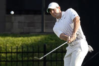 Rory McIlroy, of Northern Ireland, hits to the 16th green during the second round of the Arnold Palmer Invitational golf tournament Friday, March 5, 2021, in Orlando, Fla. (AP Photo/John Raoux)