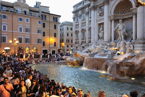 Trevi fountain in the evening twilight of old city center, Rome