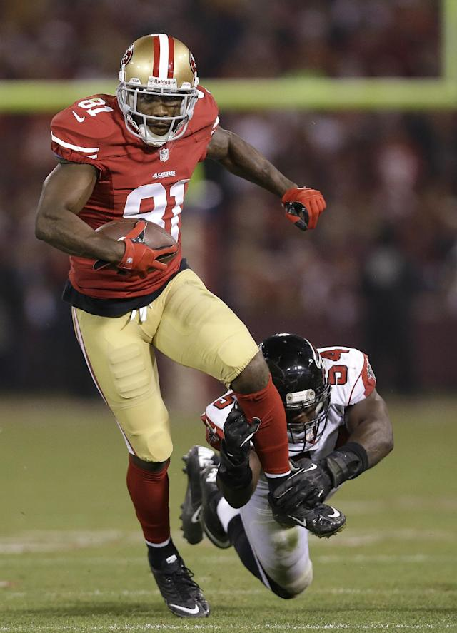 San Francisco 49ers wide receiver Anquan Boldin (81) runs past Atlanta Falcons outside linebacker Stephen Nicholas (54) during the second half of an NFL football game in San Francisco, Monday, Dec. 23, 2013. (AP Photo/Marcio Jose Sanchez)