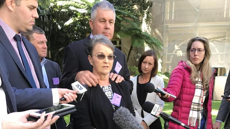 Leanne Pullen (centre) was 'shocked, angry and disappointed' at the parole of one of son's killers.