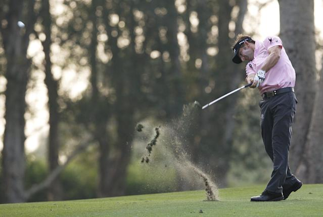 Jbe Kruger of South Africa hits the ball on the 18th hole during the Hong Kong Open golf tournament in Hong Kong, Friday, Dec. 6, 2013. (AP Photo/Kin Cheung)