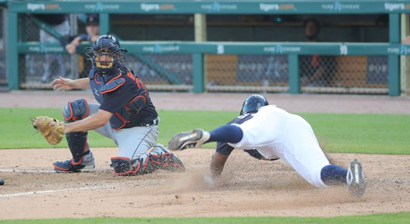 Detroit Tigers' Jonathan Schoop slides into home ahead of the tag by Jake Rogers during intrasquad action Friday, July 17, 2020 at Comerica Park in Detroit.