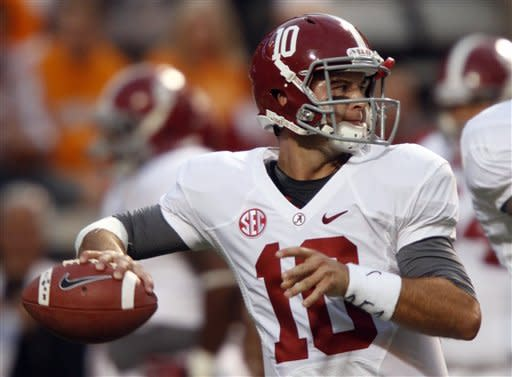 Alabama quarterback AJ McCarron (10) throws to a receiver before an NCAA college football game againstTennessee, Saturday, Oct. 20, 2012, in Knoxville, Tenn. (AP Photo/Wade Payne)